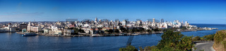 Havana. View of the old city through a bay from Morro's fortress. Panorama
