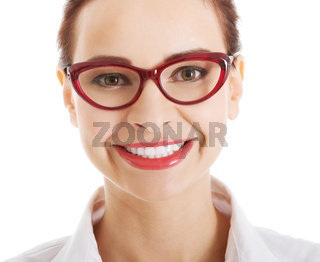 Portrait of beautiful business woman in red eyeglasses.