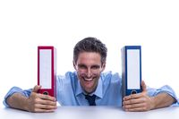 Businessman with file folders on the desk