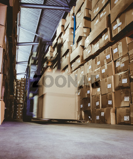 Forklift in large warehouse