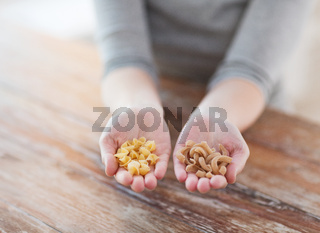 female hands with different pasta variations