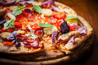 Homemade pizza with  dried tomatoes