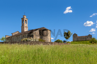 Old church under blue sky in Piedmont, Italy.
