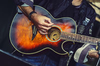 Guitar in the hands of a musician