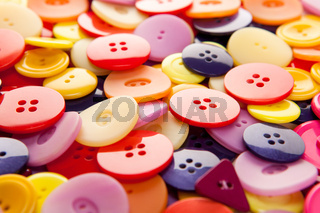 A pile of colorful buttons with depth perspective