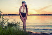 Retro-looking attractive women outdoor portrait. Girl at sunset.
