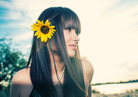 Skincare and beauty face. Sensual girl with sunflower