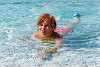 Woman bathing in the sea  (Greece).