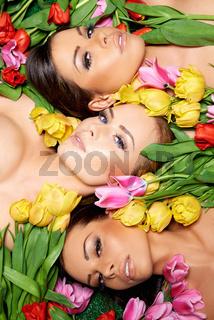 Sensual Bare Woman on Fresh Roses