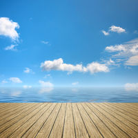 wooden jetty blue sky
