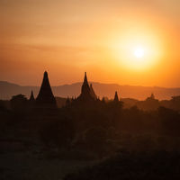 Sunset silhouettes of Buddhist Temples at Bagan Kingdom, Myanmar (Burma). Travel landscape and destinations