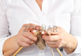 Middle age woman knitting