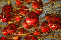 Some christmas balls decorated on a golden frame made tree