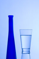 Water glass with blue bottle