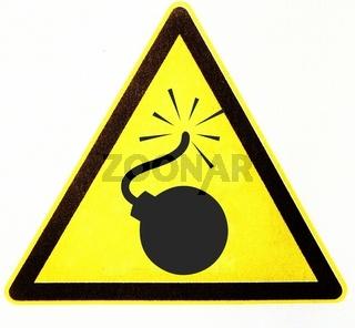 Bombe in gelben Warndreieck, symbolisch