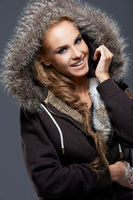Happy Woman in Jacket with Furry Hood