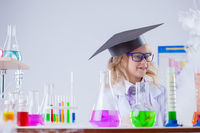 Image of cute surprised girl posing in laboratory