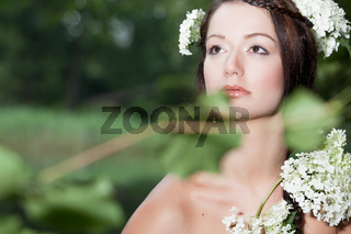 Woman is looking up in nature