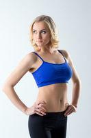 Attractive female athlete posing in studio