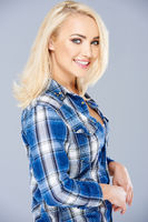 Smiling beautiful blond in a checked blue shirt