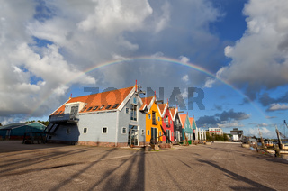 big rainbow over colorful buildings in Zoutkamp