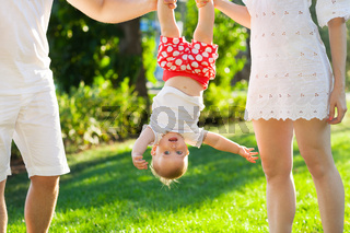 Funny family with baby girl in the park