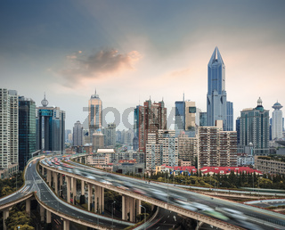 city skyline with elevated road