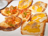 Different styles of bruschetta