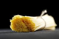 Raw pasta on black table