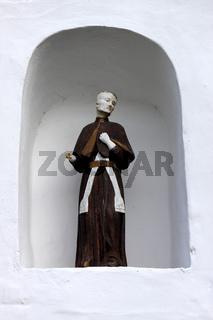 Heiligenfigur in einer Hausnische