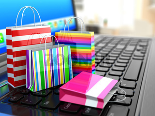E-commerce. Online internet shopping. Laptop and shopping bags.
