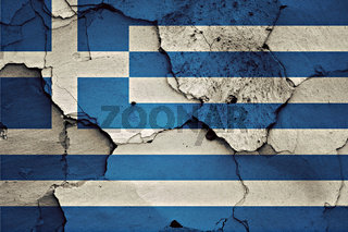 flag of Greece painted on cracked wall