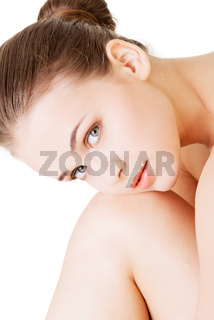 Attractive naked woman. She has her head on knee. Closeup.