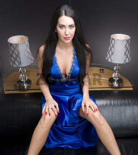 Sultry Woman Satin Blue Dress on Sofa