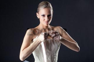 Portrait of emotional ballerina kneads pointe
