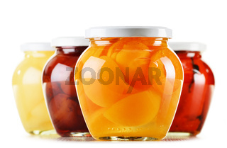 Jars with fruity compotes isolated on white background. Preserved fruits
