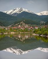 Mountain village reflection in the lake