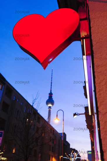 Red heart, neon sign of a sex shop in Berlin