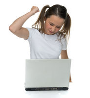 Angry young girl attacking her laptop computer