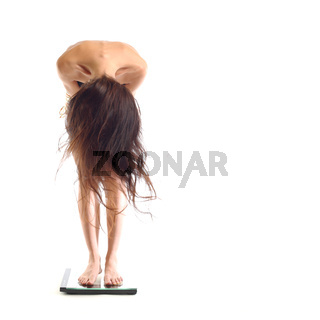 woman on scales isolated on white background