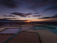 Colorful sunrise over agricultural land