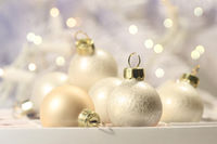 Christmas balls in box on abstract background