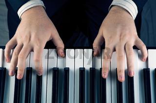 Piano keys and human hands