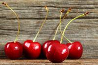 Fresh cherries in a row