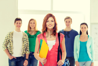 smiling students with teenage girl in front