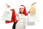 Happy santa woman with bags. Christmas shopping.