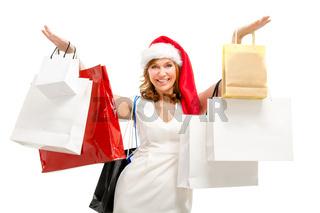Happy santa woman with bags. Christmas shopping.