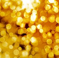 Abstract gold background with blur bokeh for design