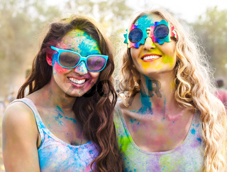 Portrait of happy girls on holi color festival