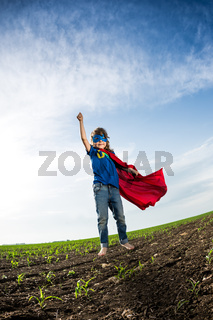 Superhero kid jumping